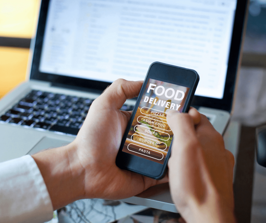 Ordering food using a Food Delivery app on a mobile phone.