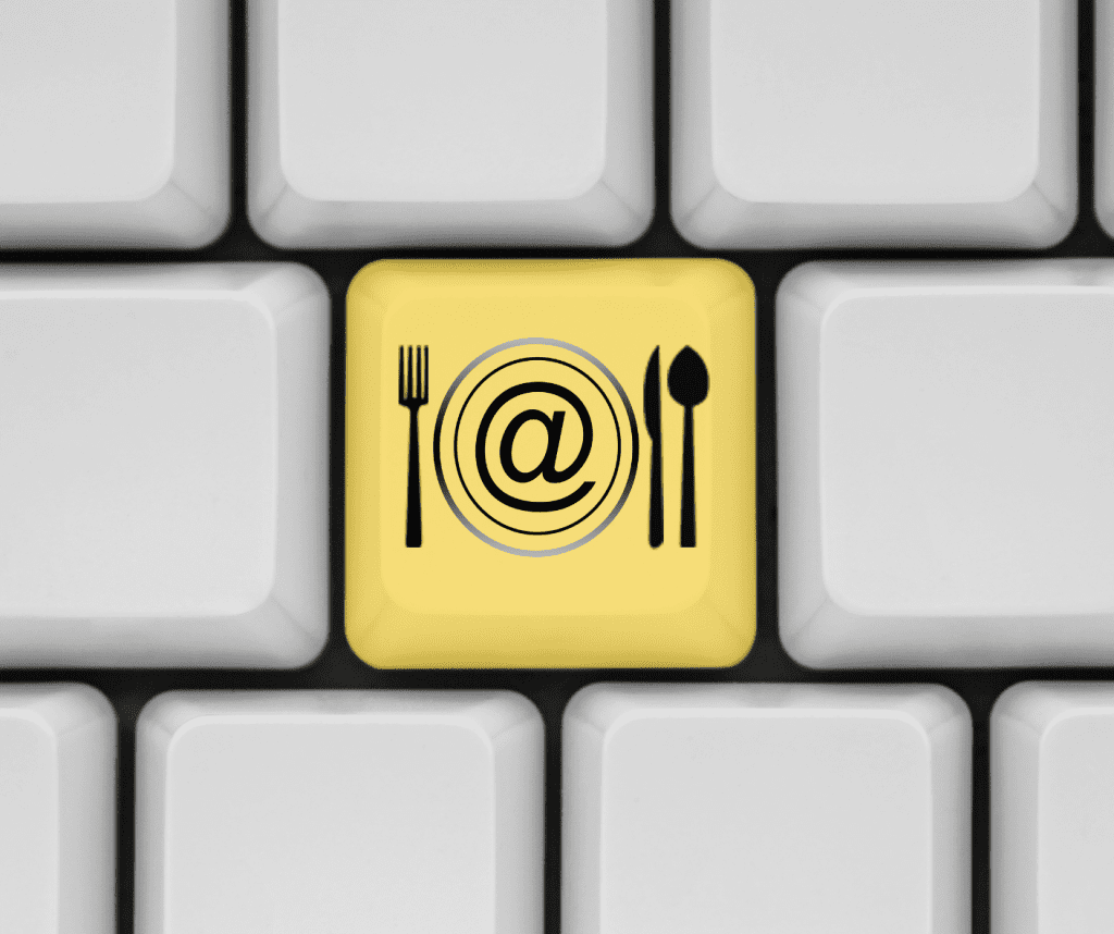 A key on a keyboard showing fork, spoon, and knife that entails easy food order tracking if a restaurant or takeaway has a mobile app.